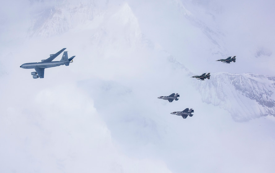 A five-ship formation of U.S. Air Force F-35A Lightning II, F-16C Fighting Falcon fighters and a KC-135R Stratotanker flies over the Joint Pacific Alaska Range Complex April 21, 2020.