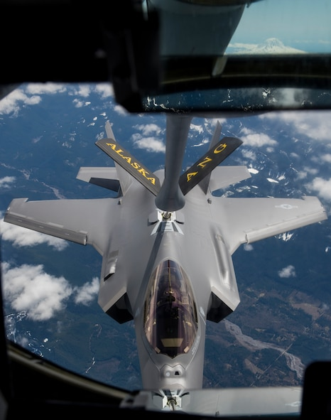 A new F-35A Lightning II refuels mid-air by a 168th Wing, Alaska Air National Guard, KC-135R Stratrotanker, enroute from the Lockheed Martin factory in Fort Worth, Texas, to the 354th Fighter Wing, Eielson Air Force Base, Alaska, April 21, 2020.