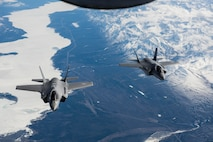 Two F-35A Lightning II aircraft fly over the Alaska Canada Highway en route to their new home at the 354th Fighter Wing, Eielson Air Force Base, Alaska, April 21, 2020.