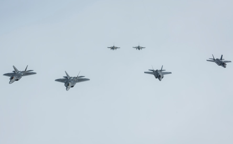 A formation of U.S. Air Force fighter aircraft stationed across Alaska fly in formation, representing the addition of the F-35A Lightning II to the fighter arsenal in Alaska, April 21, 2020.