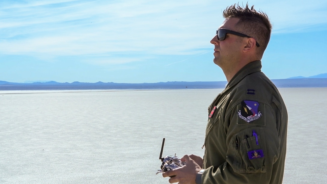 """Capt. Steve DiMaio, 412th Test Wing, Emerging Technology Combined Test Force, remotely pilots a Bob Violett Models """"Renegade"""" aircraft during a flight test on Edwards Air Force Base, California, March 4. (Air Force photo by Chris Dyer)"""