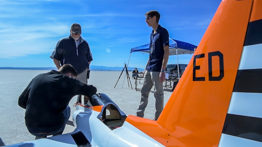 """Members of 412th Test Wing's Emerging Technology Combined Test Force, prepare a Bob Violett Models """"Renegade"""" aircraft prior to a flight test on Edwards Air Force Base, California, March 4. (Air Force photo by Chris Dyer)"""