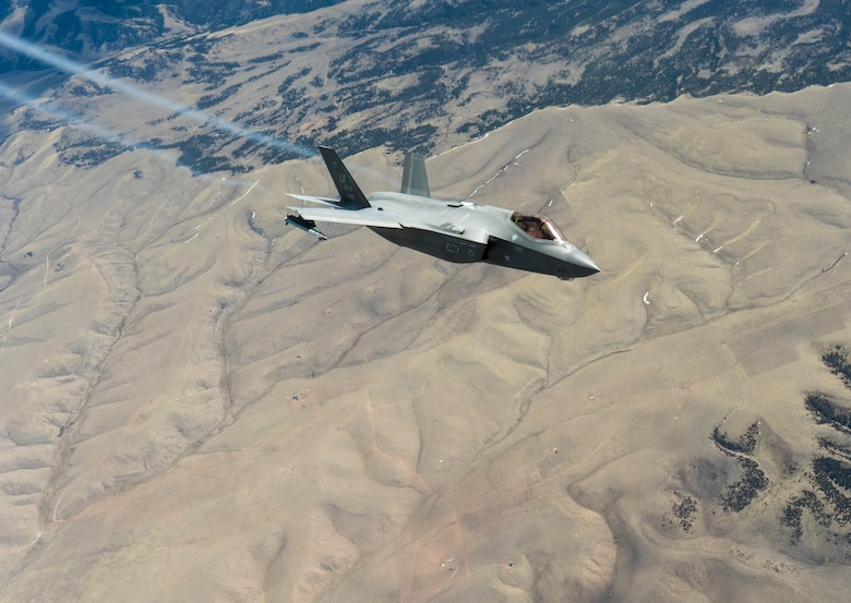 An F-35A Lightning II assigned to the 63rd Fighter Squadron at Luke Air Force Base, Ariz., banks away after receiving fuel from a KC-135 Stratotanker, assigned to the Arizona Air National Guard, 161st Air Fueling Wing April 17, 2020, over Colorado.