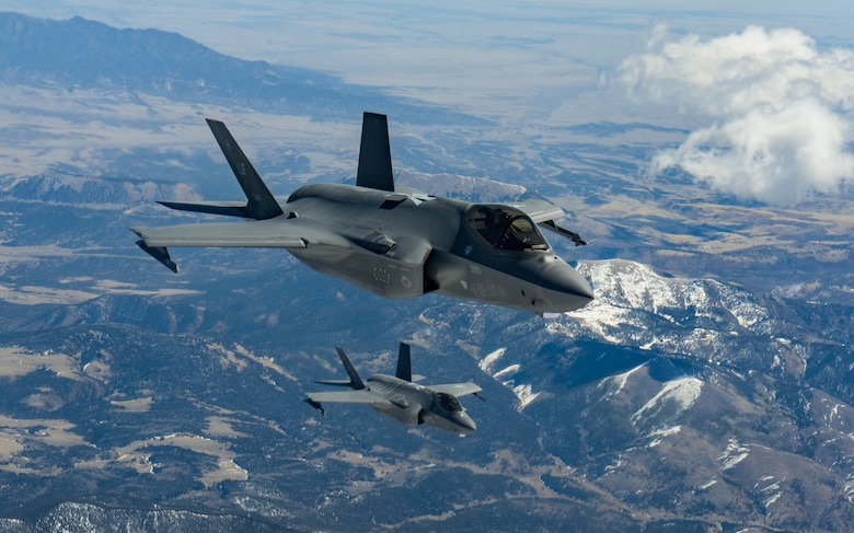 Two F-35A Lightning IIs assigned to the 56th Fighter Wing at Luke Air Force Base, Ariz., fly over Colorado during a refueling mission April 17, 2020.