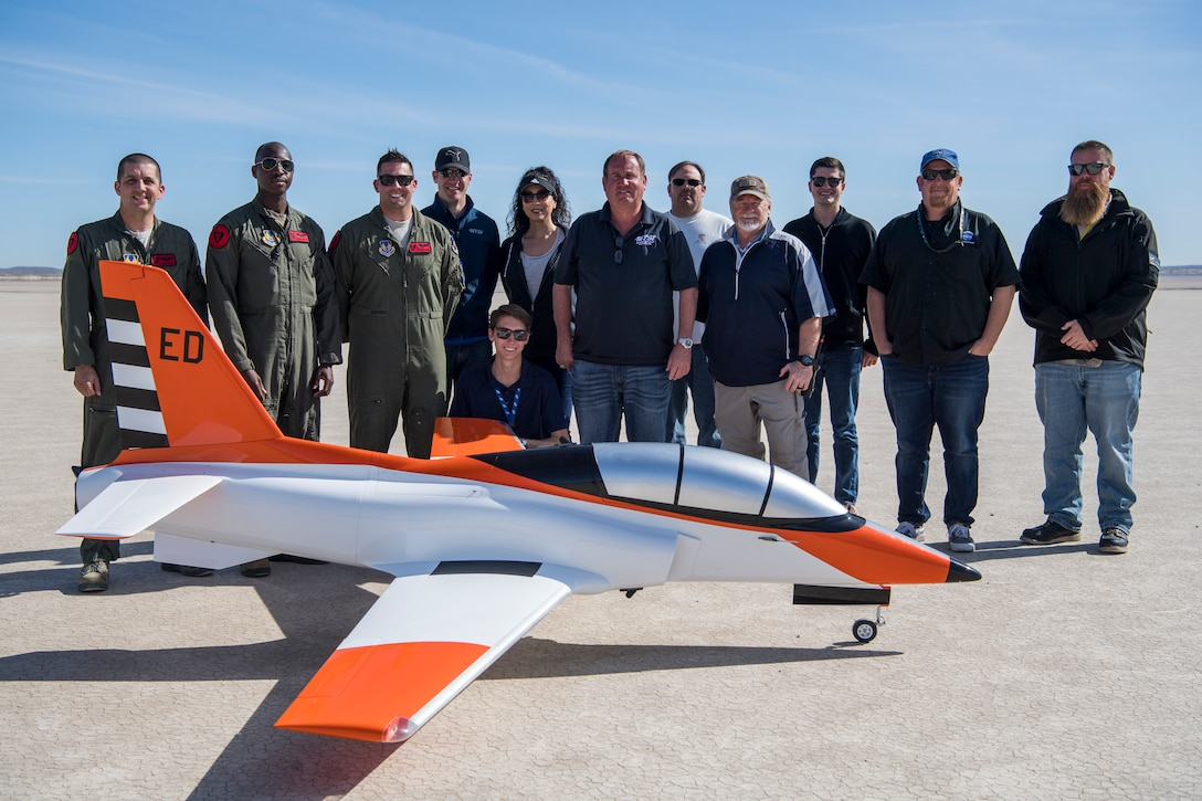 """The 412th Test Wing's Emerging Technology Combined Test Force team pose for a photo with their Bob Violett Models """"Renegade"""" aircraft following a test flight at Edwards Air Force Base, California, March 4. (Air Force photo by Chris Dyer)"""