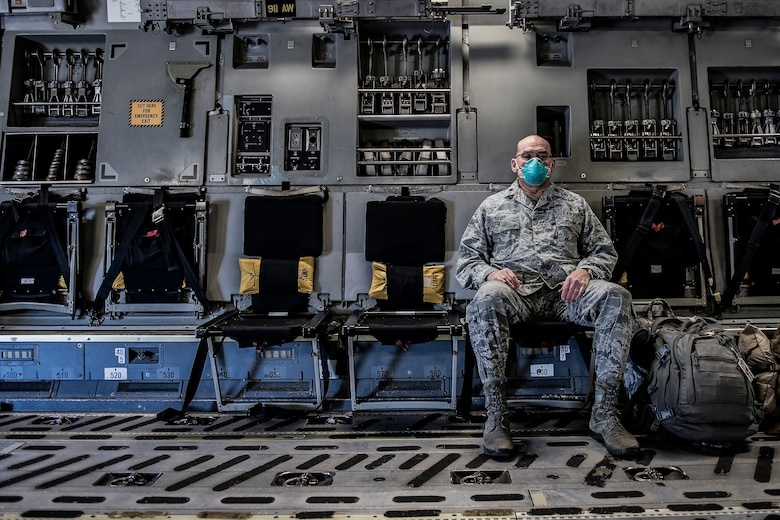 Lt. Col. David Severs, 911th Aeromedical Staging Squadron clinical nurse, sits in a C-17 Globemaster III before departing Pittsburgh International Airport Air Reserve Station, Pennsylvania, April 22, 2020.
