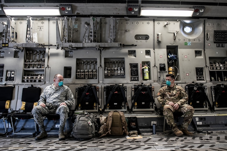 Lt. Col. David Severs, 911th Aeromedical Staging Squadron clinical nurse, talks with Lt. Col. Charles Giordano, 911th ASTS certified registered nurse anesthetist, inside a C-17 Globemaster III before departing Pittsburgh International Airport Air Reserve Station, Pennsylvania, April 22, 2020.