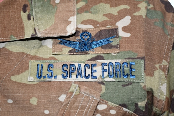 U.S. Air Force Airmen who transfer into the U.S. Space Force will continue to wear the Operational Camouflage Pattern utility uniform currently worn by USAF and U.S. Army personnel, but with distinct blue thread and a colored U.S. flag on the left arm. The USSF is the sixth branch of the U.S. Armed Forces and is part of the Department of the Air Force.