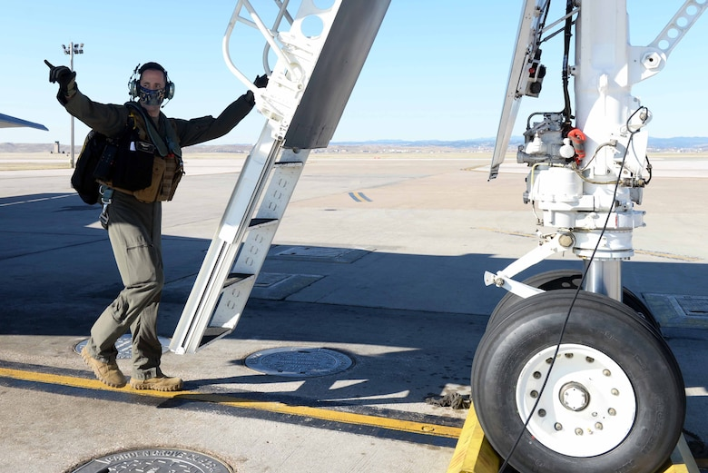U.S. Air Force Capt. Lance Huston, a 37th Bomb Squadron weapons systems officer, prepares to board a B-1B Lancer at Ellsworth Air Force Base, S.D., April 21, 2020. Aircrew from the 37th BS flew a B-1B Lancer from the continental United States and integrated with the Koku Jieitai (Japan Air Self Defense Force or JASDF) to conduct bilateral and theater familiarization training near Japan. (U.S. Air Force photo by Airman Quentin K. Marx)