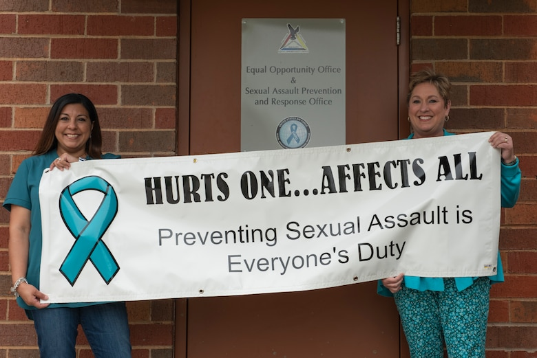 Marisa Hensley, 7th Bomb Wing sexual assault prevention and response victim advocate, left, and Elaine Stirling, 7th BW sexual assault response coordinator, hold up a banner at Dyess Air Force Base, Texas, April 20, 2020. Hensley and Stirling work together to arrange events and outreach programs to raise awareness and support for sexual assault victims. (U.S. Air Force photo by Airman 1st Class Colin Hollowell)
