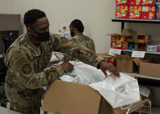 U.S. Air Force Staff Sgt. Tristan Traore, a 6th Force Support Squadron readiness NCO, sorts through care packages at the Military and Family Readiness Center (MFRC) at MacDill Air Force Base, Fla., April 17, 2020.