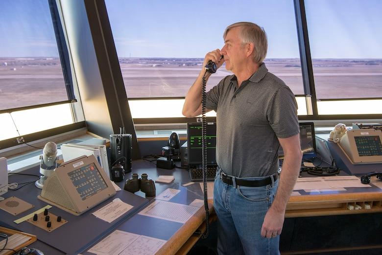ATC Tower controller talking on radio