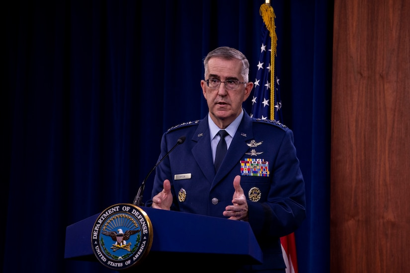Air Force officer stands at lectern.
