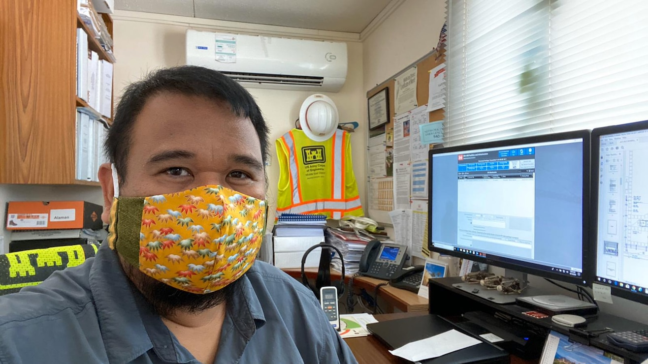 Mechanical Engineer Ryan Alaman rocks his reversible face cover, thanks to Emma Wanamaker, wife of CPT Grant Wanamaker, who made face covers for everyone in the Bahrain Resident Office.