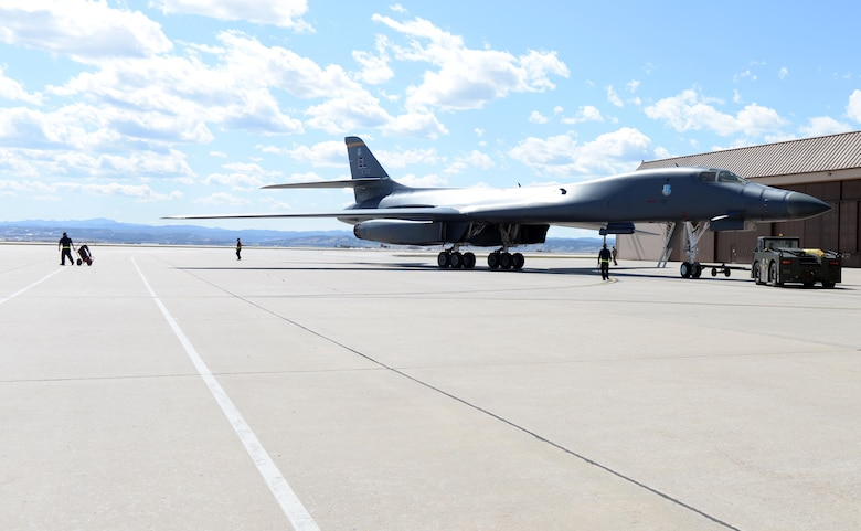 A B-1B Lancer is towed to a parking spot on the apron of the airfield at Ellsworth Air Force Base, S.D., April 22, 2020.