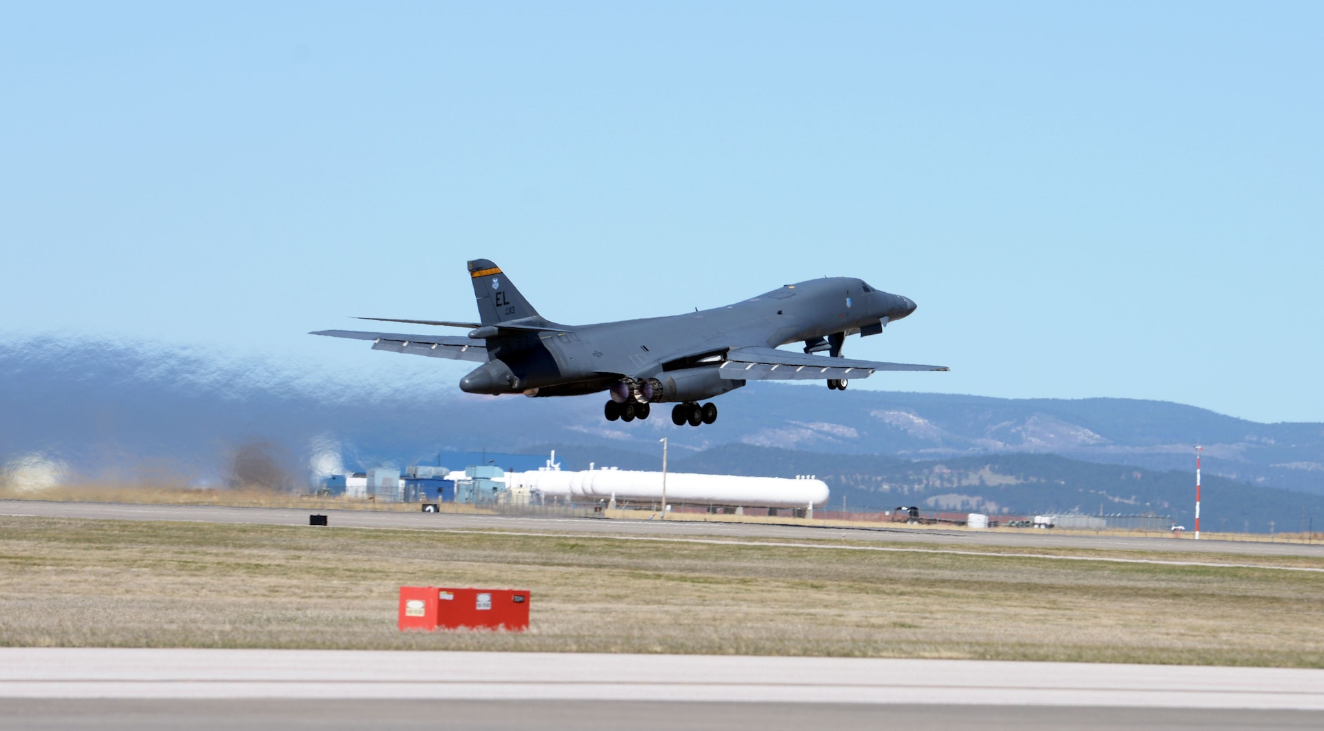 A U.S. Air Force B-1B Lancer thunders down the runway at Ellsworth Air Force Base, S.D., April 21, 2020. The B-1 bomber flew from the continental United States and integrated with the Koku Jieitai (Japan Air Self Defense Force or JASDF) to conduct bilateral and theater familiarization training near Japan. (U.S. Air Force photo by Airman Quentin K. Marx)