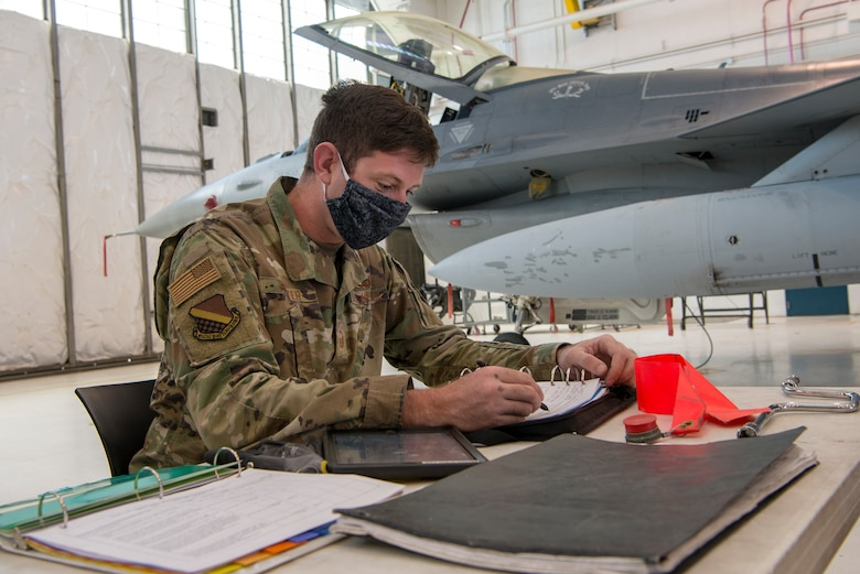Maintenance airman working with mask on