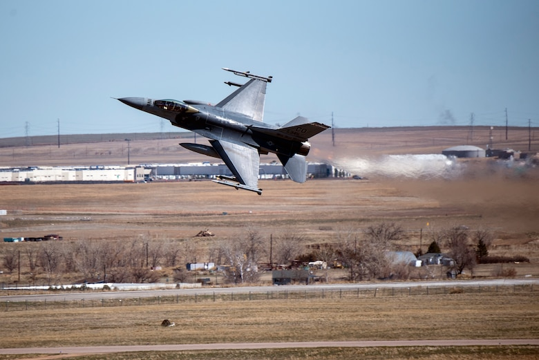 F-16 taking off over Buckley AFB