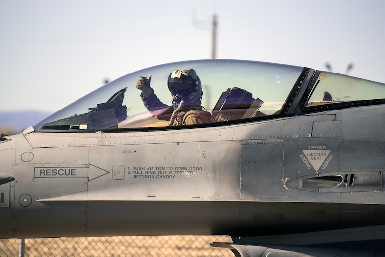 Pilot gives thumbs up in cockpit