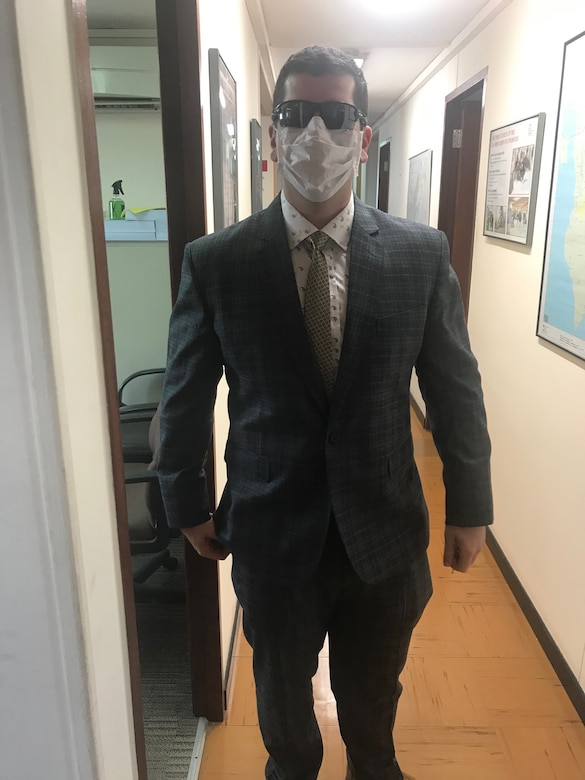 Bahrain Resident Office project manager forward CPT Grant Wanamaker, COVID-19 style, prepares to venture out to meet with stockholders and take delivery of some vital documents.