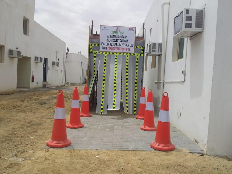 Protecting workers through disinfection tunnel at Artillery Project, Al-Yamama Company, Dammam, in the Kingdom of Saudi Arabia.