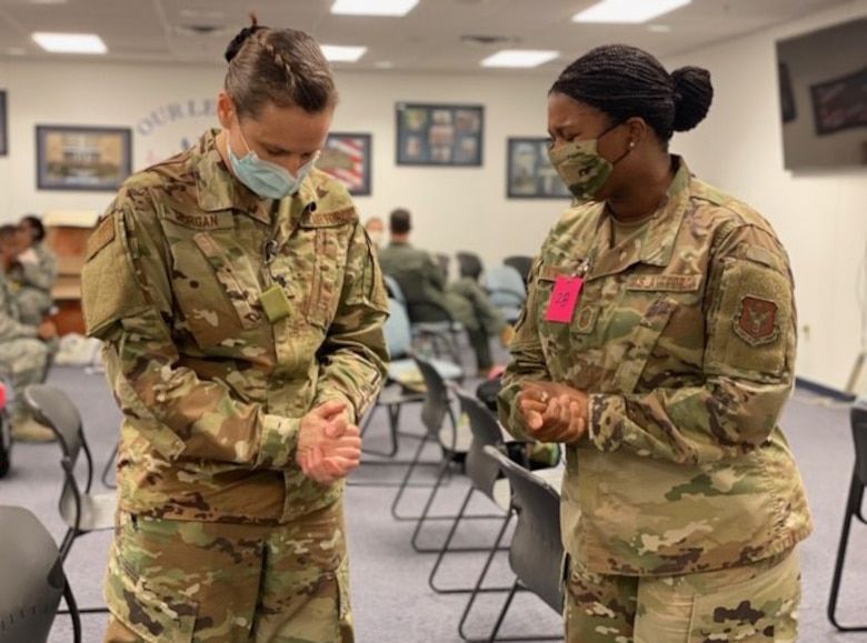 Lt. Col. Kimberly Morgan, 301st Medical Squadron aerospace family nurse practitioner, and Senior Master Sgt. Jonique Young, 301st Fighter Wing Religious Affairs superintendent, take a moment on April 22, 2020, before the former deploys in support of COVID-19 relief efforts from U.S. Naval Air Station Joint Reserve Base, Fort Worth, Texas. This deployment is part of a larger mobilization package of more than 770 Air Force Reservists from across the nation who are taking care of Americans fighting COVID-19. (U.S. Air Force photo by Capt. Jessica Gross)