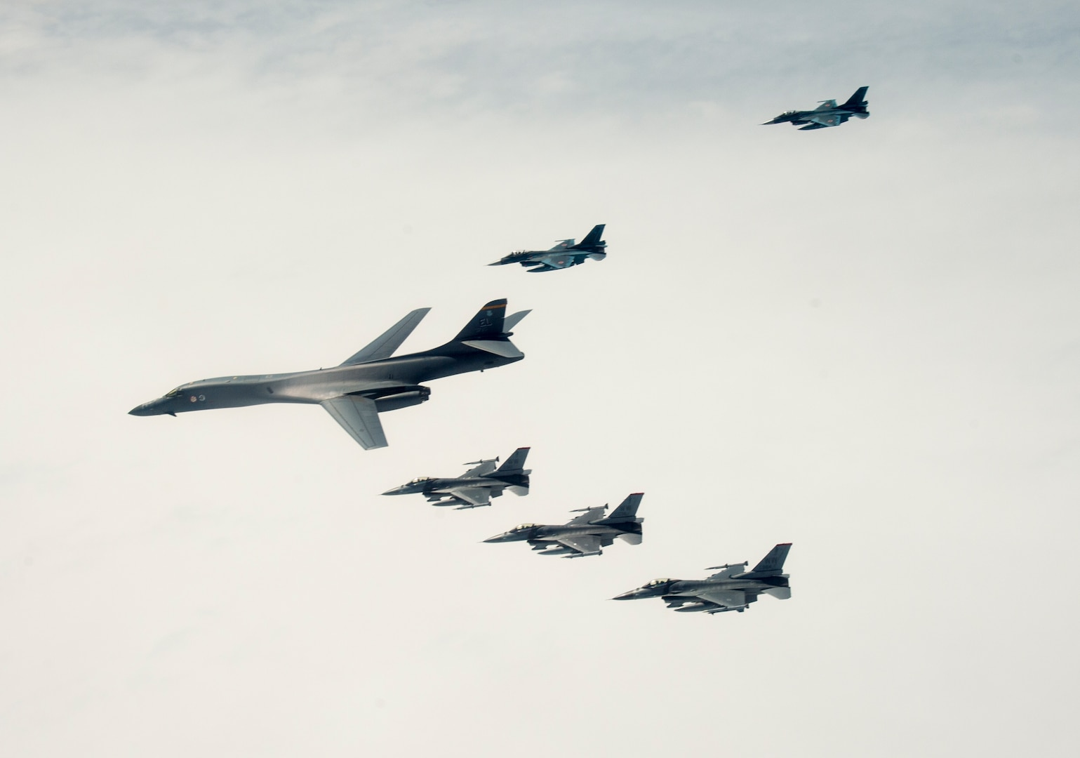 A U.S. Air Force B-1B Lancer from Ellsworth Air Force Base, S.D. and F-16 Fighting Falcons from Misawa Air Base, Japan, conducted bilateral joint training with Japan Air Self-Defense Force (JASDF) F-2s off the coast of Northern Japan, April 22, 2020. U.S. Strategic Command's bomber forces regularly conduct combined theater security cooperation engagements with allies and partners, demonstrating U.S. capability to command, control and conduct bomber missions around the world. (U.S. Air Force photo by Tech. Sgt. Timothy Moore)