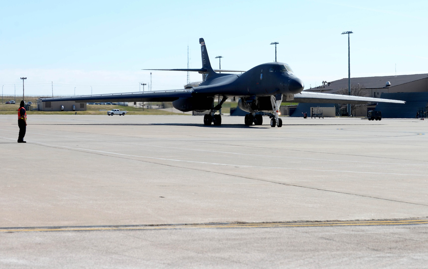 A U.S. Air Force B-1B Lancer is marshaled to the taxiway at Ellsworth Air Force Base, S.D., April 21, 2020. The B-1B's speed and superior handling characteristics allow it to seamlessly integrate in mixed force packages. (U.S. Air Force photo by Airman Quentin K. Marx)