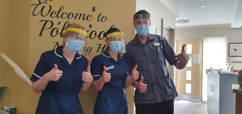 Polebroke Nursing and Residential Home staff members pose for a group photo wearing face shields donated by James Anderson in Polebrook, England, April 17, 2020. (Courtesy photo)