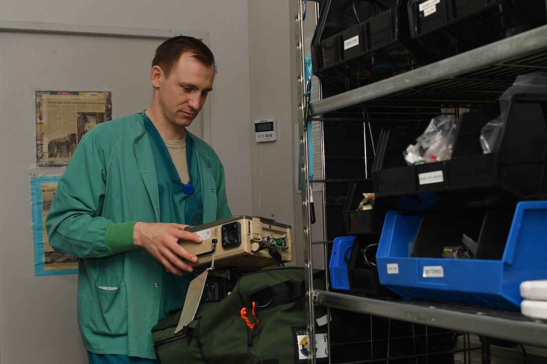 A medical worker holding medical equipment.