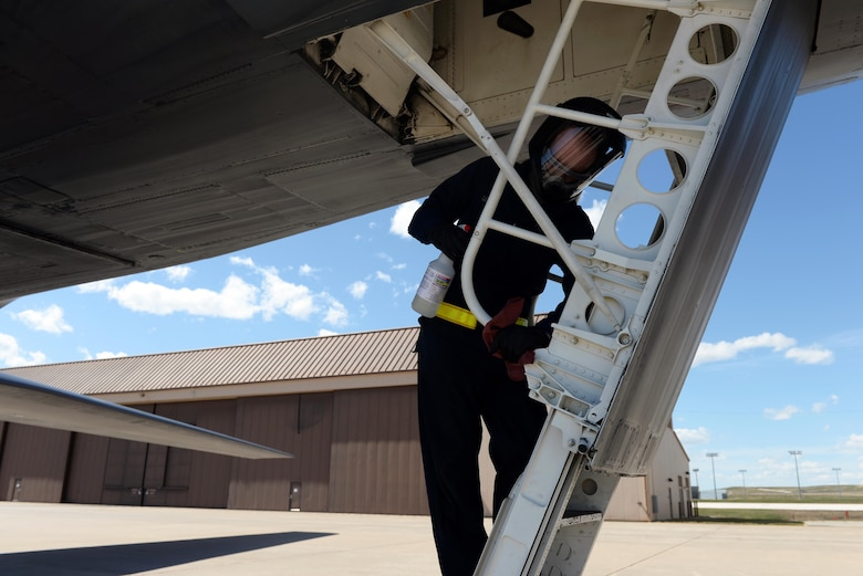 A maintainer assigned to the 28th Aircraft Maintenance Squadron wipes down the ladder of a B-1B Lancer at Ellsworth Air Force Base, S.D., April 22, 2020.