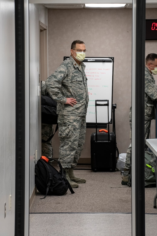 Airman looks at a metal detector