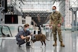 Army Spc. John Ward, a behavioral health technician assigned to the 405th Field Hospital, introduces a service member to Mila, a therapy dog used as a stress reliever for service members at the Javits New York Medical Station in New York City, April 17, 2020. In support of the Defense Department's COVID-19 response, U.S. Northern Command, through Army North, is supporting the Federal Emergency Management Agency to help communities in need.