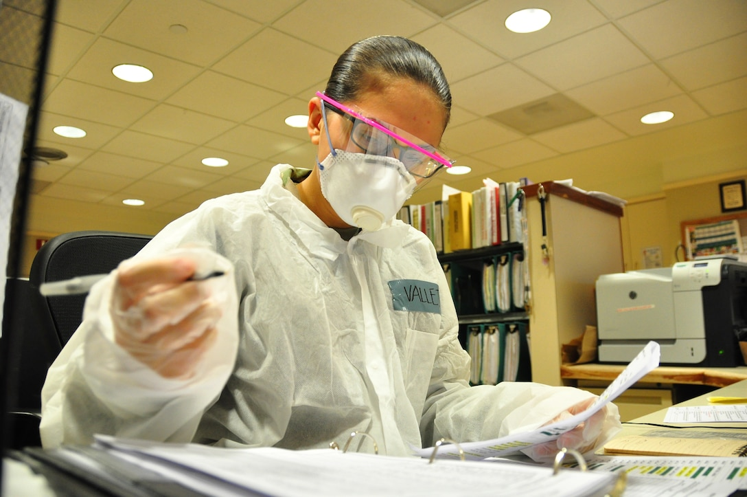 A picture of U.S. Army Pfc. Victoria Vallejo, a Motor Transport Operator with the 250th Brigade Support Battalion, New Jersey Army National Guard, updating medical paperwork.