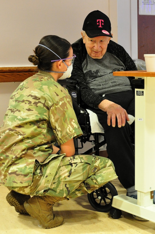 U.S. Army Spc. Laurel Yerg, a Combat Medic with the 1st Battalion, 114th Infantry Regiment, New Jersey Army National Guard, checking on a resident.