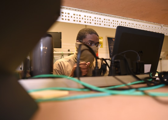 U.S. Air Force Senior Airman Lydell Mitchel, 17 Communications Squadron client systems technician, fixes a laptop while wearing a mask and keeps a social distance in the image lab on Goodfellow Air Force Base, Texas, April 22, 2020. The 17th CS kept the mission vibrant by preparing essential personnel with devices and enabling members to work from home during this pandemic.(U.S. Air Force Photo by Airman 1st Class Abbey Rieves)