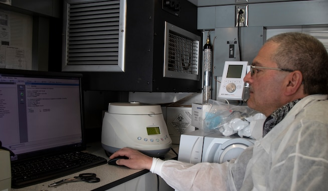U.S. Army Reserve Maj. Dmitry Pervistky, a bio-chemist with the 773rd Civil Support Team, 7th Mission Support Command, from Kaiserslautern, Germany, conducts personal training and validation of an Analytical Laboratory System prior to testing Soldiers for Novel Coronavirus at Drawsko Pomorskie Training Area, Poland, April 14, 2020. A team of four Soldiers from the 773rd CST is charged with testing incoming personnel to ensure they are not introducing COVID to a relatively COVID-free environment.   (U.S. Army Reserve photo by Staff Sgt. Chris Jackson/Released)