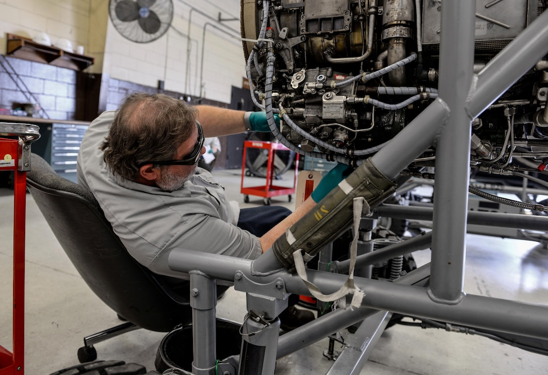 Frank Hall, M1 Support Services propulsion mechanic, performs maintenance on a General Electric J85-GE-5 turbojet engine April 17, 2020, at Columbus Air Force Base, Miss. Propulsion means to push or drive an object forward, and these engines help power the wing's T-38 Talons. (U.S. Air Force photo by Airman 1st Class Davis Donaldson)