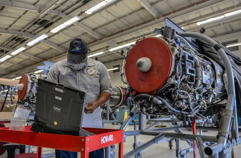 Willy Latham, M1 Support Services propulsion mechanic, gathers tools in order to perform maintenance on a General Electric J85-GE-5 turbojet engine April 17, 2020, at Columbus Air Force Base, Miss. The T-38 Talon is equipped with two General Electric J85-GE-5 turbojet engines. (U.S. Air Force photo by Airman 1st Class Davis Donaldson)
