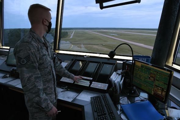 Staff Sgt. Glen Simmons, 14th Operations Support Squadron Air Traffic controller, keeps track of aircraft in and out of the airspace April 22, 2020, on Columbus Air Force Base, Miss. Tower personnel are responsible for ensuring the safe and orderly control of aircraft on the airfield and in the immediate surrounding airspace. (U.S. Air Force photo by Airman 1st Class Jake Jacobsen)