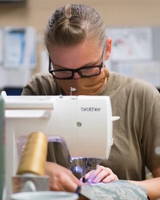 Staff Sgt. Terri Miller, 944th Air Reserve aircraft metals technology technician, sews face masks April, 9, 2020, at Luke Air Force Base, Ariz.