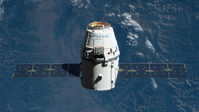 Space X's Crew Dragon, shown here with its solar arrays deployed during its first re-flight to the International Space Station for NASA. During a presentation on SpaceX's latest developments and future launches shared to 50th Wing Staff Agency Airmen on April 17, the Japanese astronaut Soichi Noguchi, elaborated on the design and technologic advancements featured on the spacecraft.