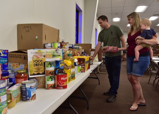 U.S. Air Force Capt. Jonathan Shour, 17th Training Wing chaplain, organizes donations during a food drive at Trinity Lutheran Church in San Angelo, Texas, April 22, 2020. The food drive is a joint effort between Goodfellow Air Force Base and the local community to help with shortages at local food banks. (U.S. Air Force photo by Staff Sgt. Chad Warren)