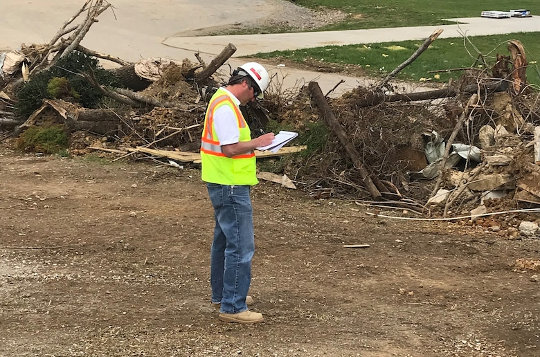 Chad Braun, civil engineer with the U.S. Army Engineering and Support Center in Huntsville, Alabama, takes notes at a debris site in Putnam County, Tennessee, April 20, 2020 while supporting a USACE debris technical assistance mission from FEMA in the wake of tornadoes that devastated the region March 3. Braun is a former employee of the Nashville District, and volunteered to support this mission in the region he used to call home. (USACE Photo)