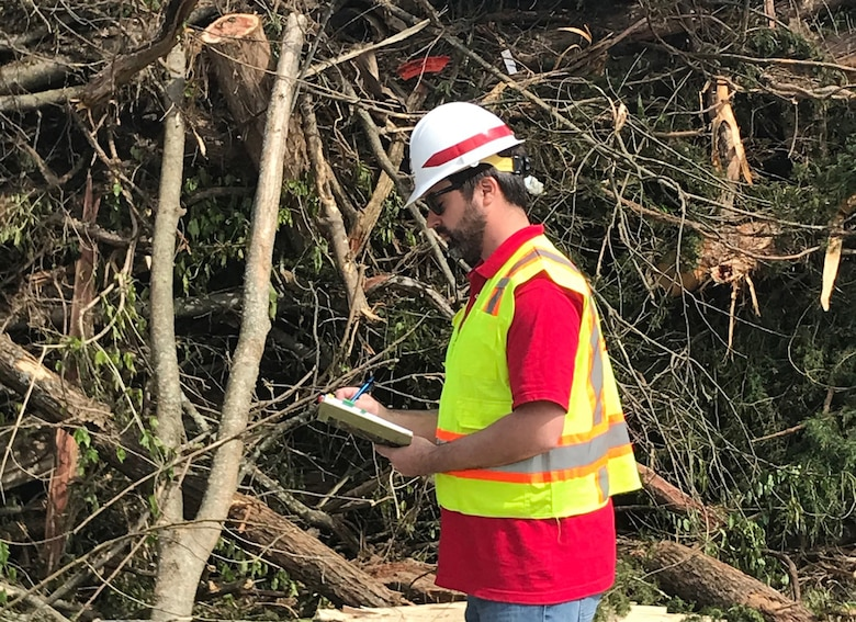 Herb Bullock, civil engineer with the Mobile District, takes notes at a temporary debris management site in Lebanon, Tennessee, April 19, 2020 while supporting a U.S. Army Corps of Engineers debris monitoring mission from FEMA in the wake of tornadoes that devastated the region March 3. (USACE Photo)