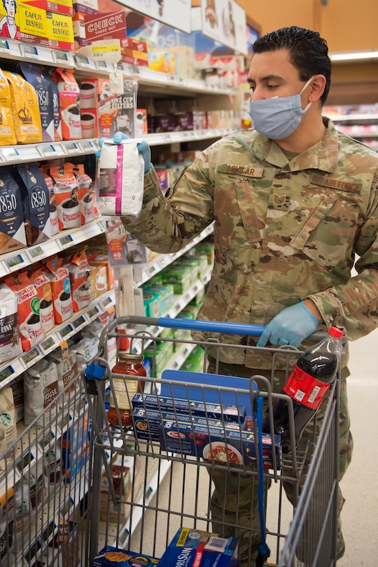 Tech. Sgt. Justin Aguilar, logistics test and evaluator, 412th Maintenance Logistics Test Squadron, shops for essentials at the Edwards Air Force Base commissary, April 22.  (Photo by Christian Turner)