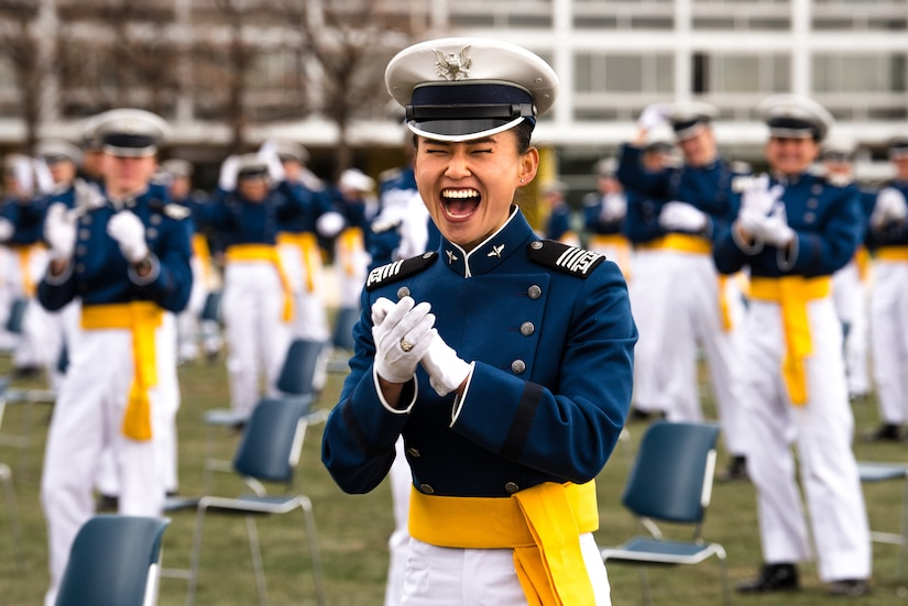 A female cadet claps and screams in joy.