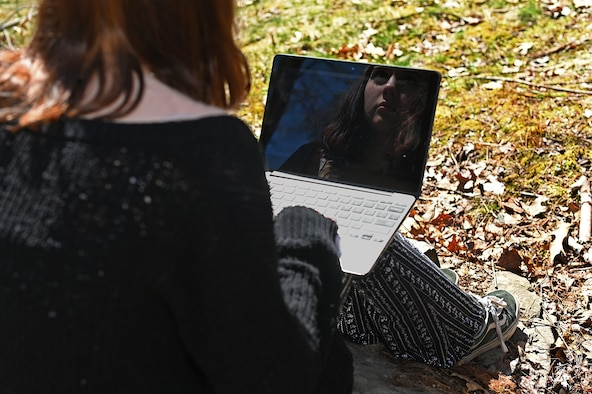 A high school student scrolls through social media at her home outside Hanscom Air Force Base, Mass., April 23. The 66th Medical Squadron Family Advocacy Program is counseling families of high school-aged children who are struggling with missing milestones due to COVID-19 restrictions. (U.S. Air Force photo by Todd Maki)