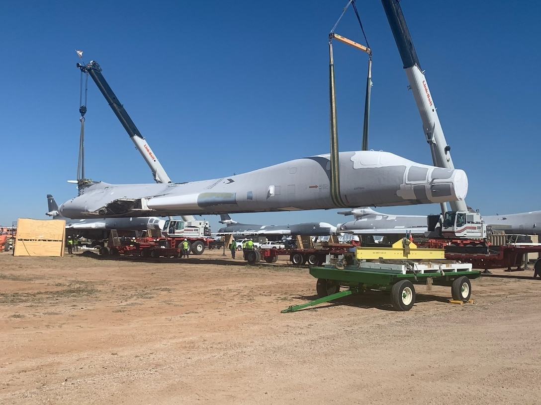 B-1B tail #85-0092 is lifted and placed on flatbed trailers for the 1,000 mile journey to Wichita, Kansas.  The National Institute for Aviation Research at Wichita State University will scan every part of the aircraft to create a digital twin that can be used for research.  (US Air Force Photo)