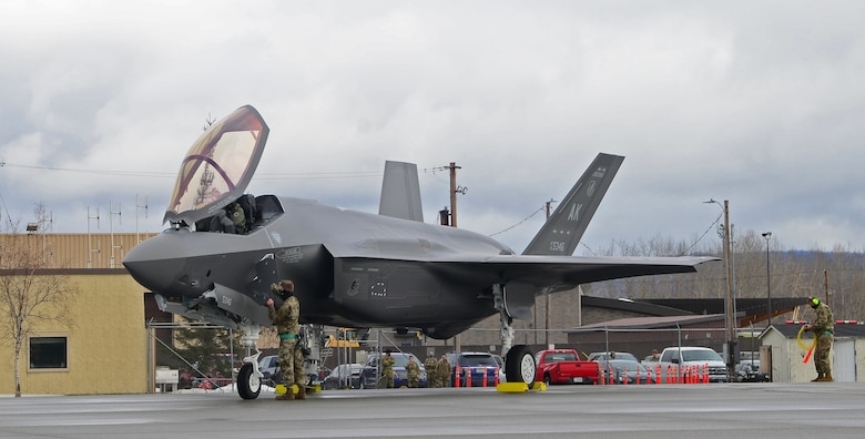 U.S. Air Force Staff Sgt. Christopher Trimarco and Staff Sgt. Kyle Fong, both from the 356th Aircraft Maintenance Unit, perform post flight procedures on the squadron's first assigned F-35A Lighting II fifth-generation fighter at Eielson Air Force Base, Alaska, April 21, 2020.